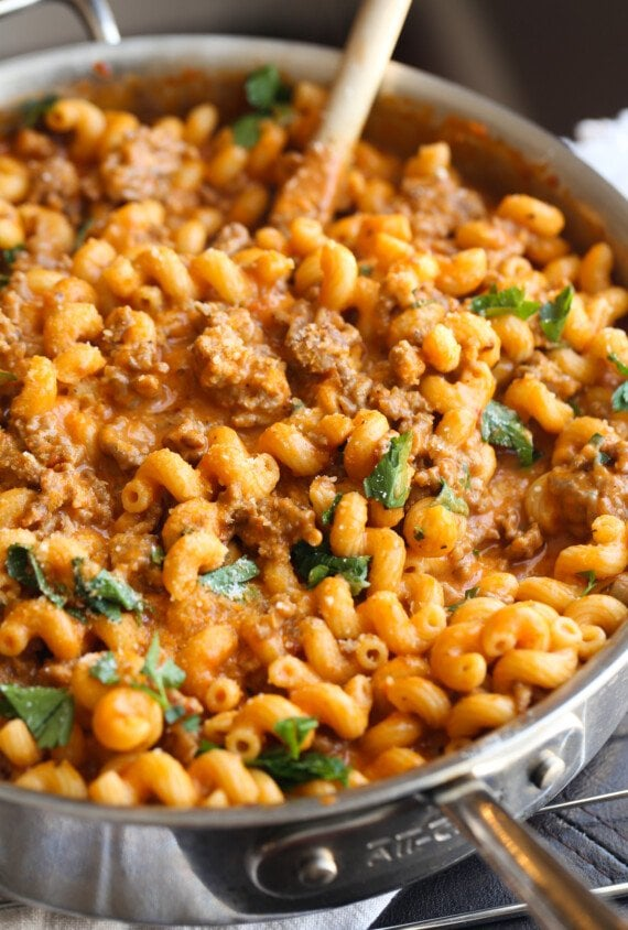 Large skillet filled with creamy sausage pasta