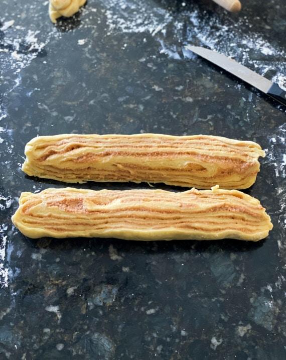 A log of dough sliced in half.
