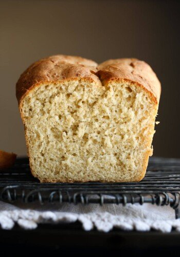 Sliced loaf of honey oatmeal bread.
