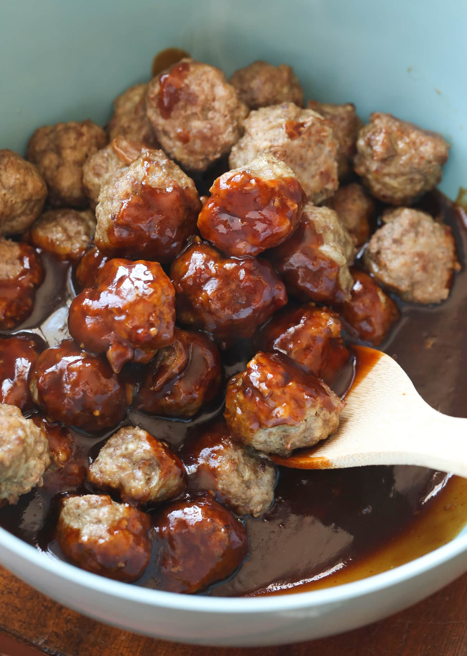 Cooked meatballs in homemade sesame sauce.