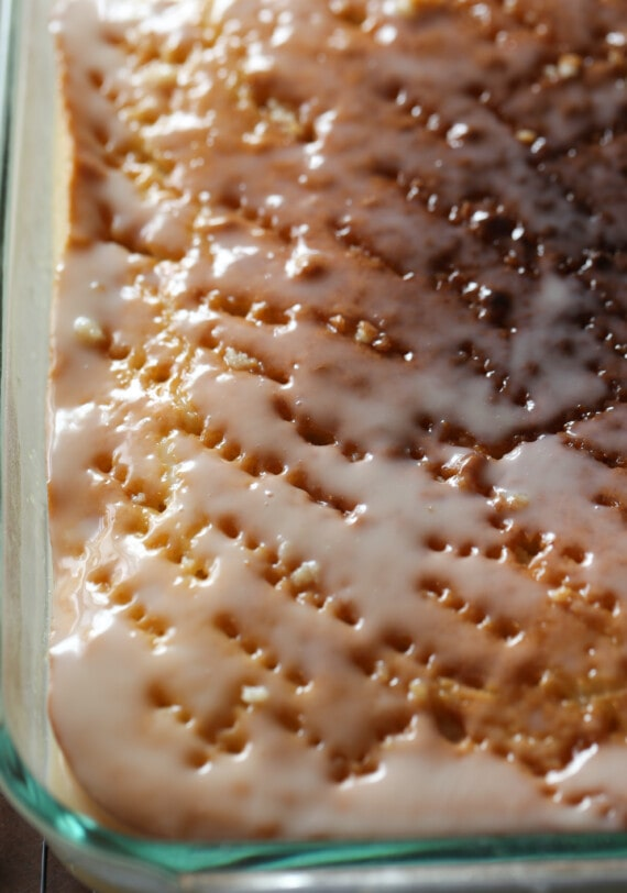 Cake with holes poked in and glaze on top