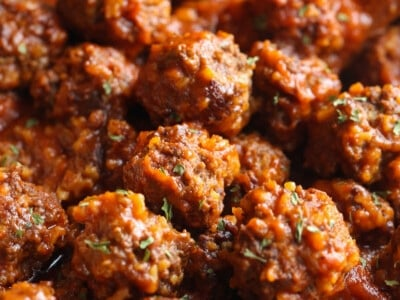 Beef meatballs packed with rice in a saucepan.