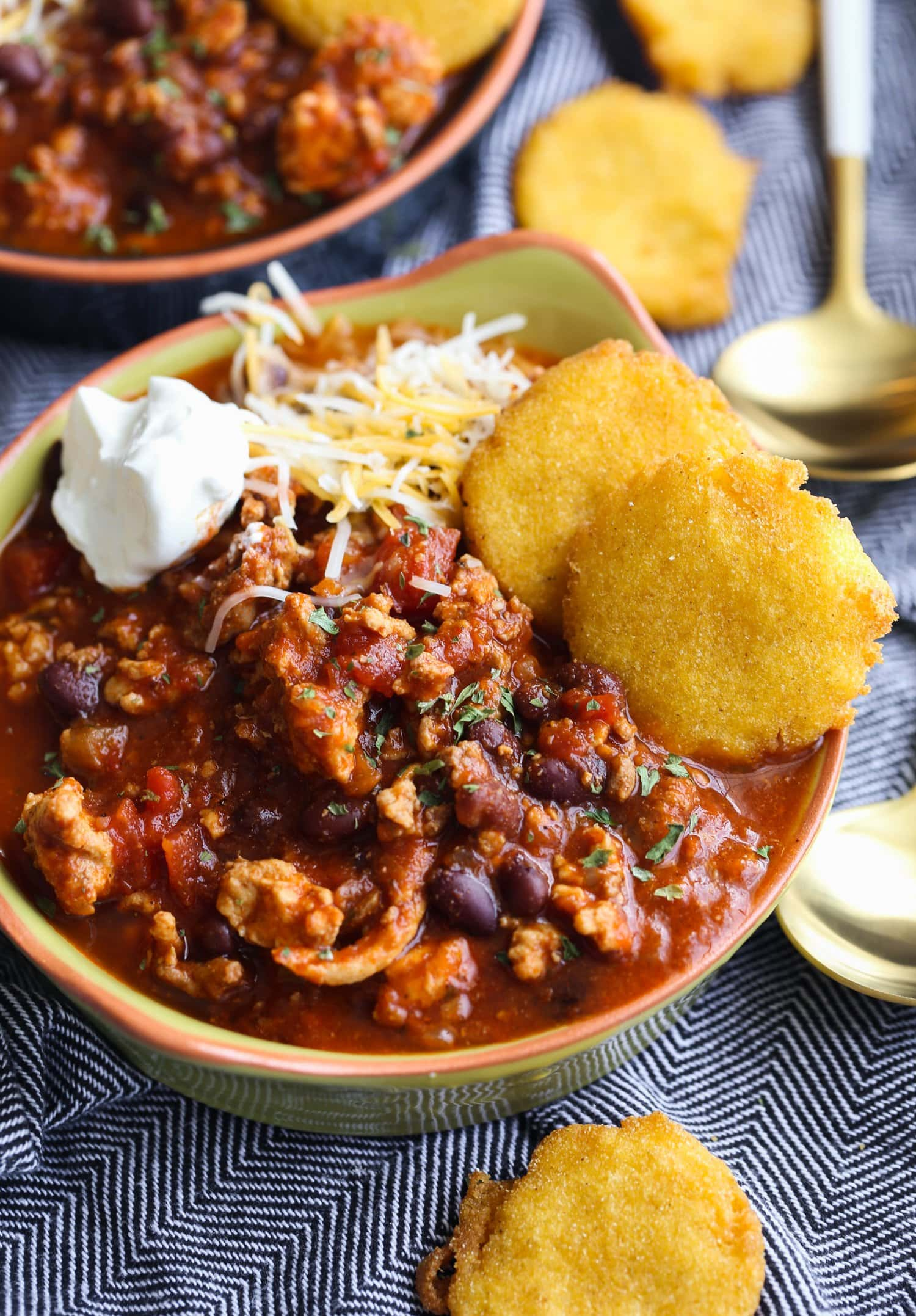 Turkey chili with sour cream and cheese.