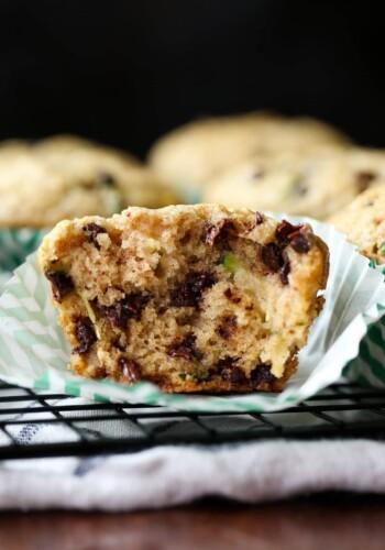 Zucchini Muffin broken in half on a cupcake liner