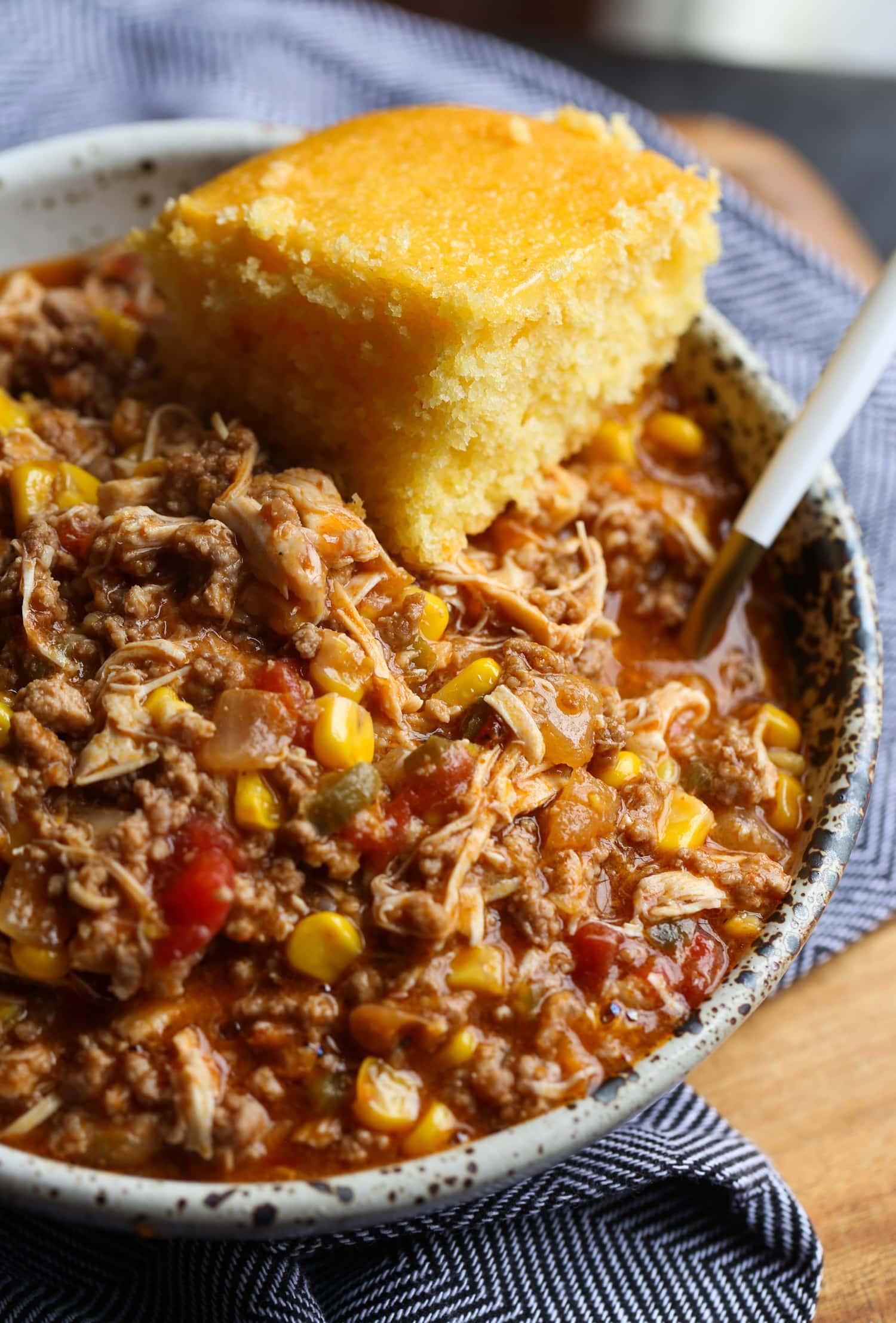 Chicken, pork, and beef stew with cornbread.