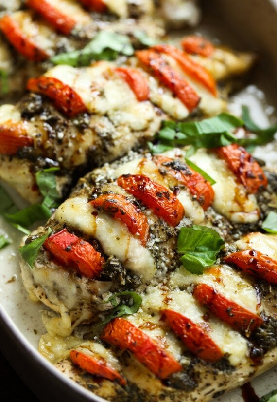Caprese Chicken in a baking dish garnished with basil