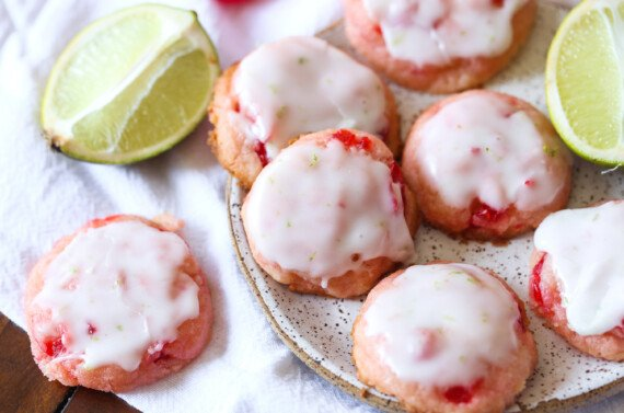 cherry cookies with lime icing on a plate