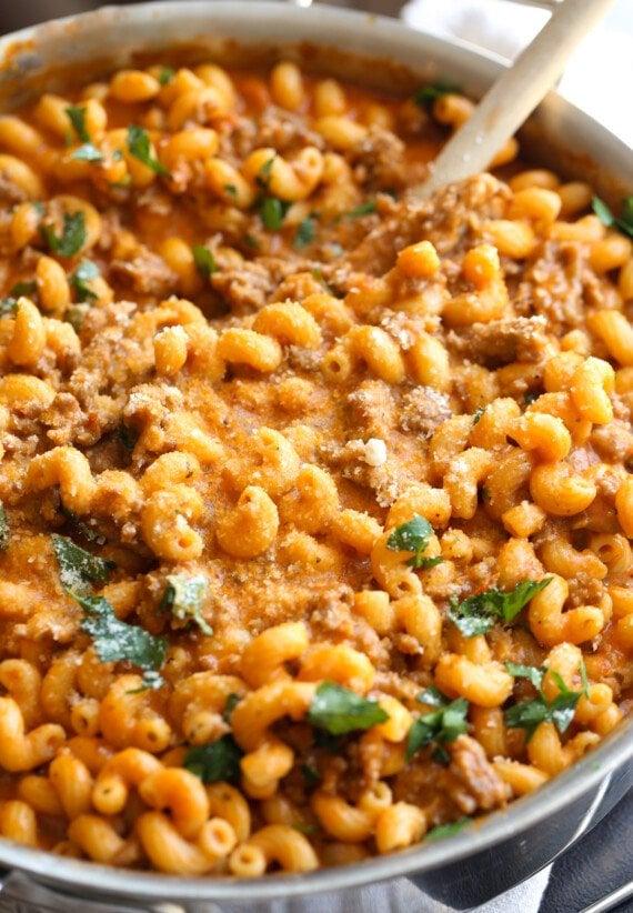 Creamy Italian sausage pasta in a skillet.