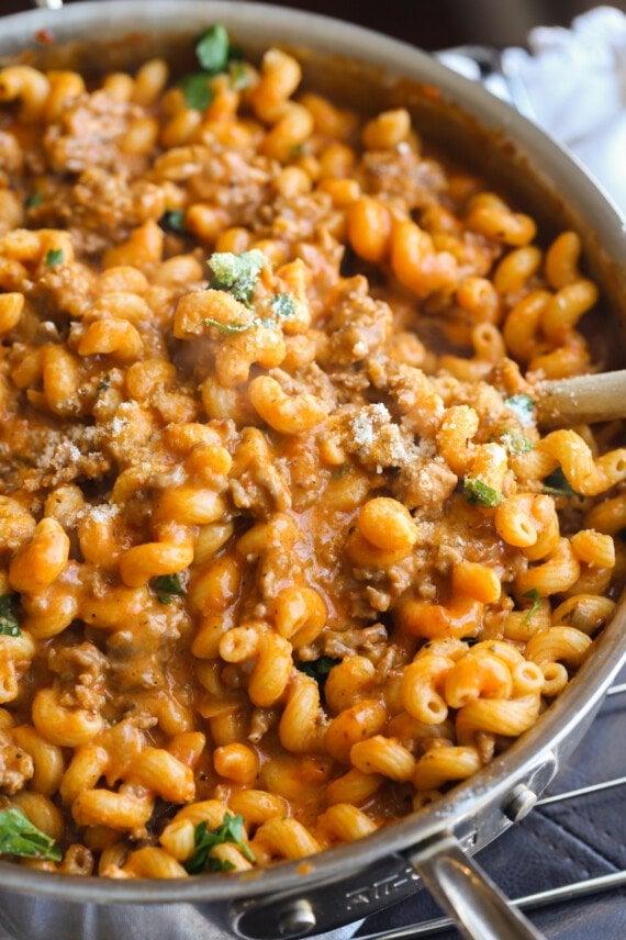 Cheesy cavatappi pasta with ground sausage.