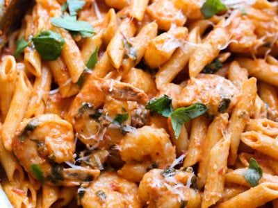 Creamy Shrimp Pasta in a large skillet with a fresh basil garnish