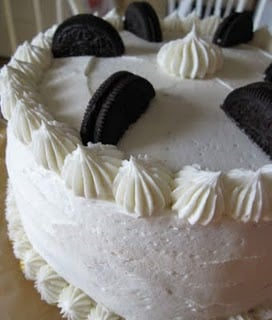 A Chocolate Cake with Vanilla Buttercream Frosting and Oreo Cookies on Top