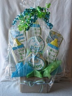 A Packaged Cookie Bouquet with Green and Blue Ribbons Tying Off the Plastic Covering