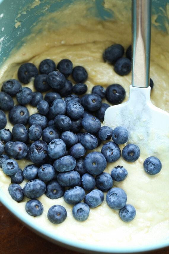 Fresh blueberries mixed into banana muffin batter.