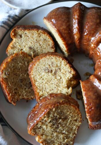 Sliced banana pound cake on a plate.
