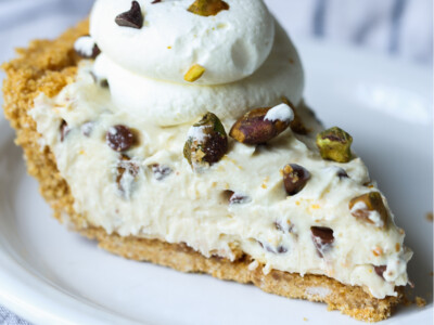 Slice of cannoli cheesecake on a plate