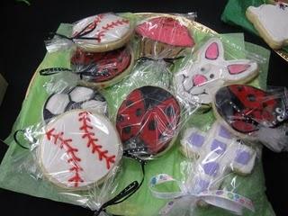 Baseball, Ladybug, Bunny and Cross Cookies on a Table at a Craft Fair