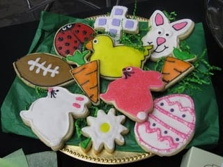 A Gold Plate of Easter-Themed Cookies Lined with Green Parchment Paper