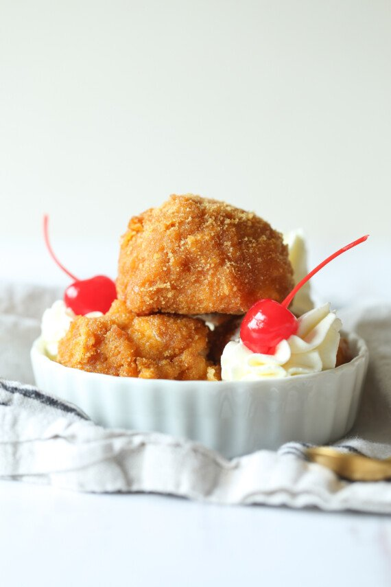 Fried ice cream scoops in a bowl.
