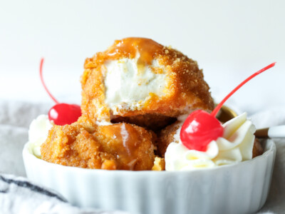 Fried ice cream with whipped cream and cherries.