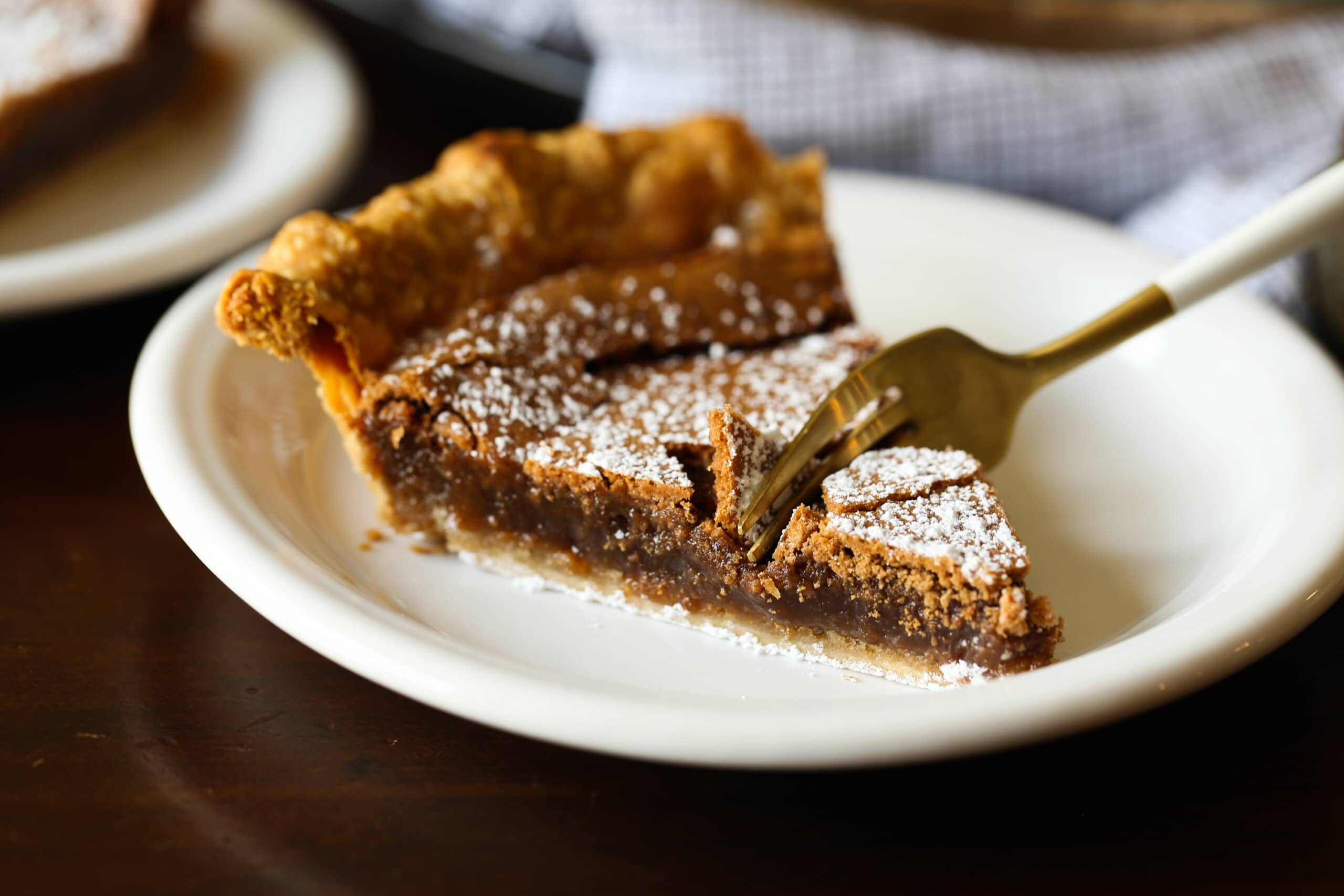 a fork taking a bite of chocolate chess pie