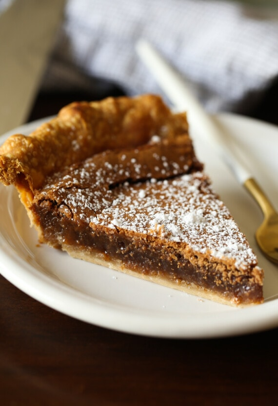 Slice of chocolate chess pie on a plate