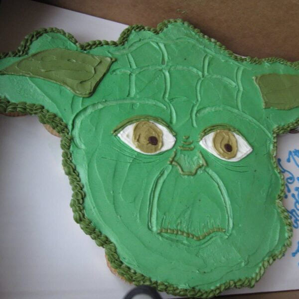 A close-up shot of a Yoda cupcake cake inside of a cardboard box