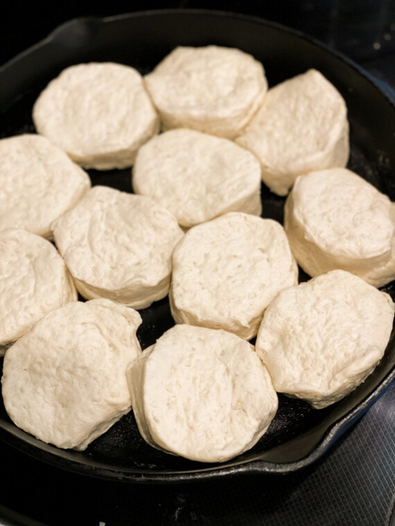 raw canned biscuits in a cast iron skillet