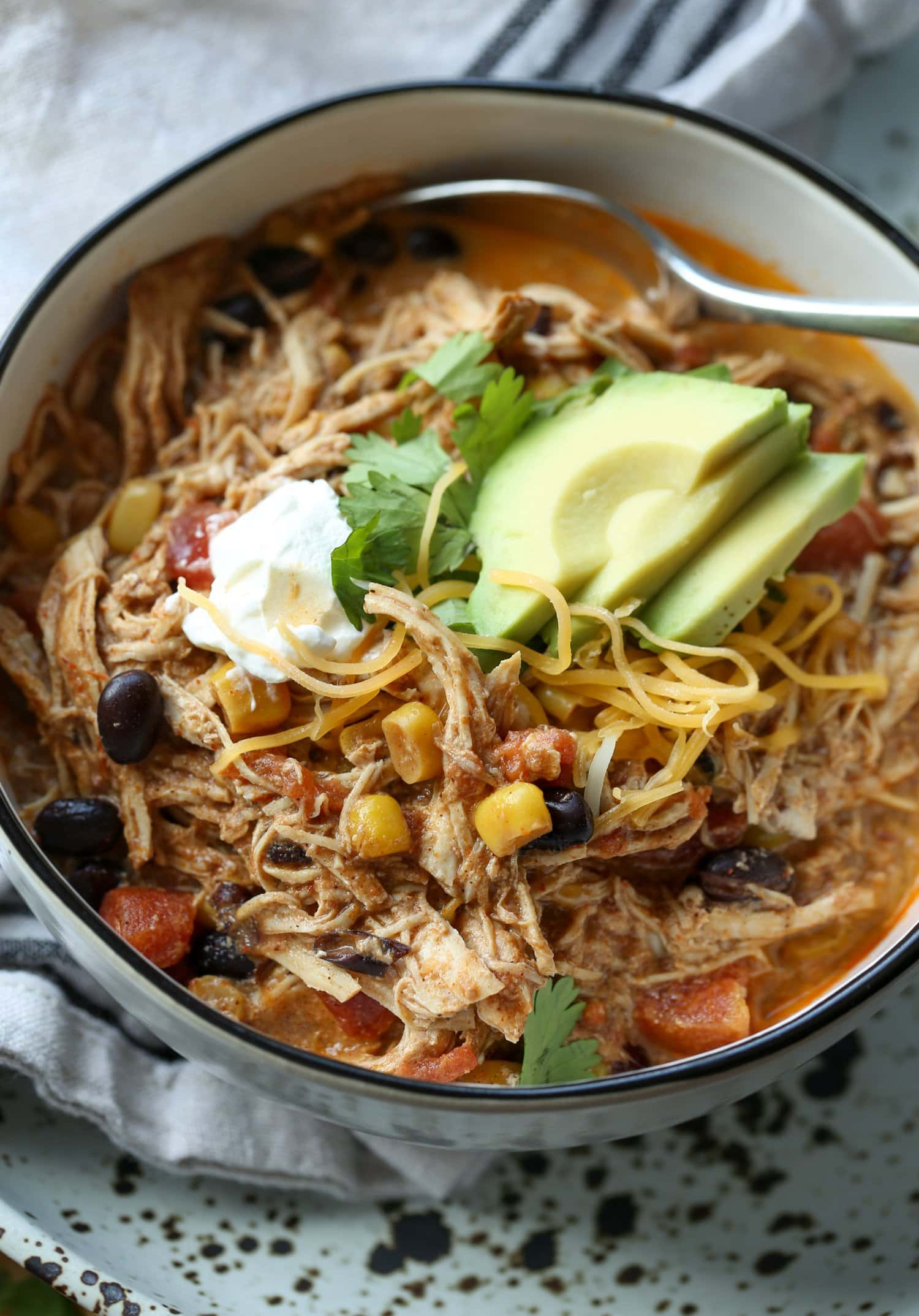 shredded tex mex chicken soup in a bowl