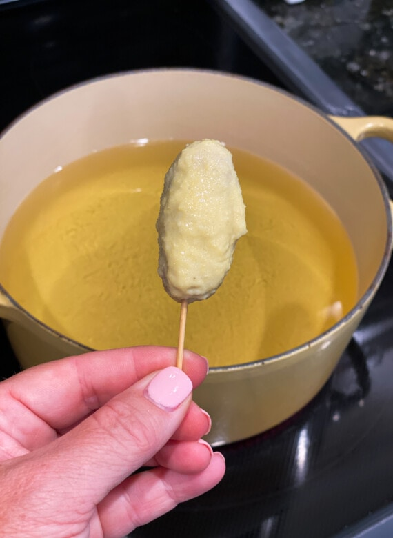 Cocktail wiener covered in cornmeal batter.