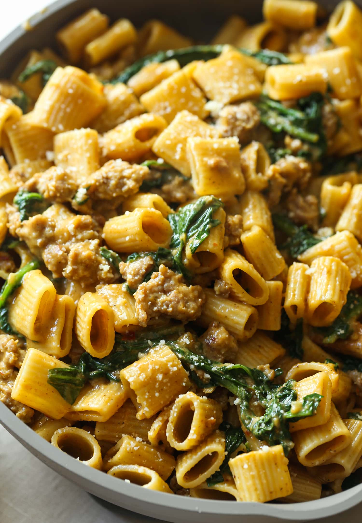 Rigatoni in a cream sauce with spinach and sausage.