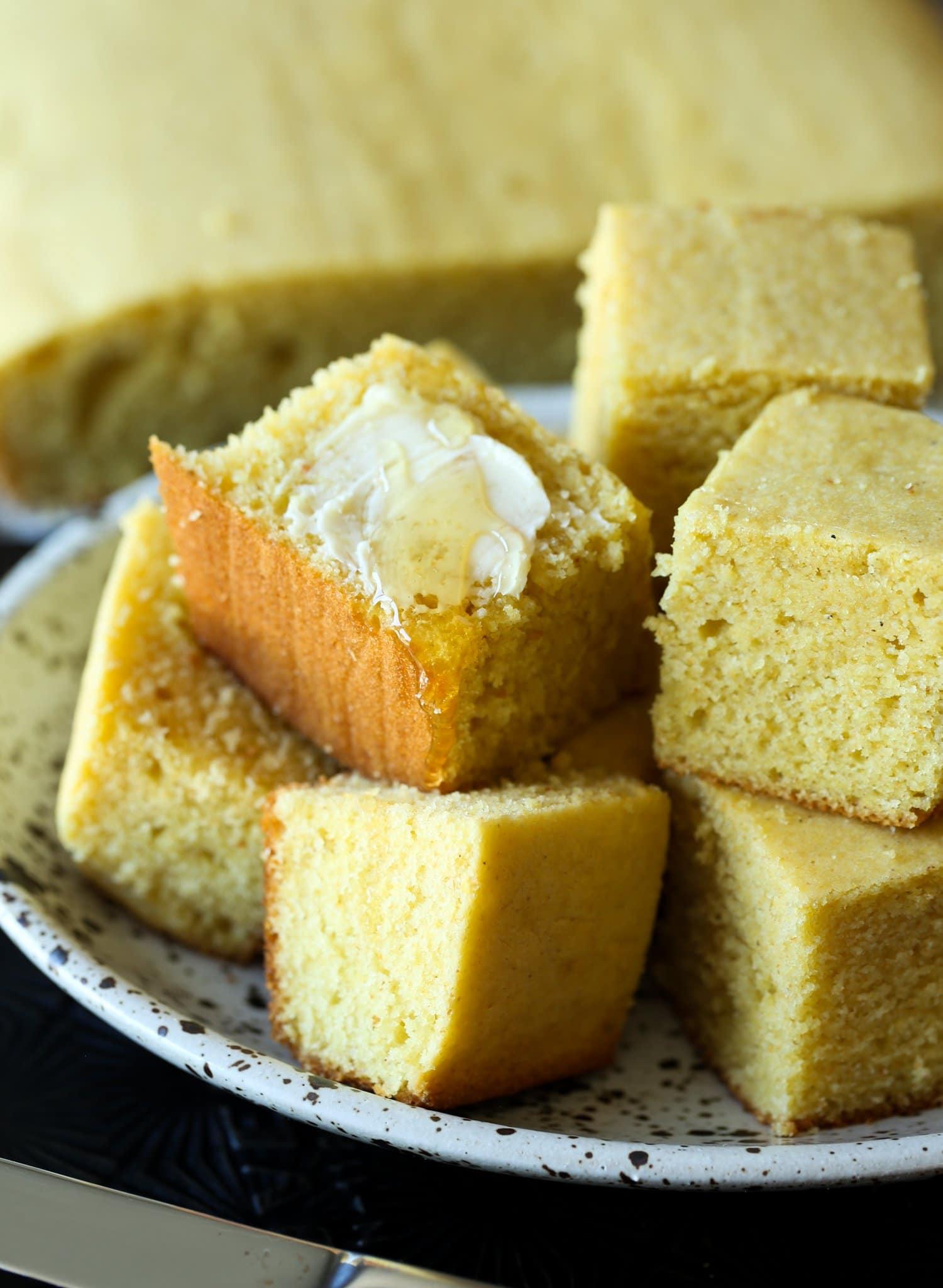 Squares of sour cream cornbread.
