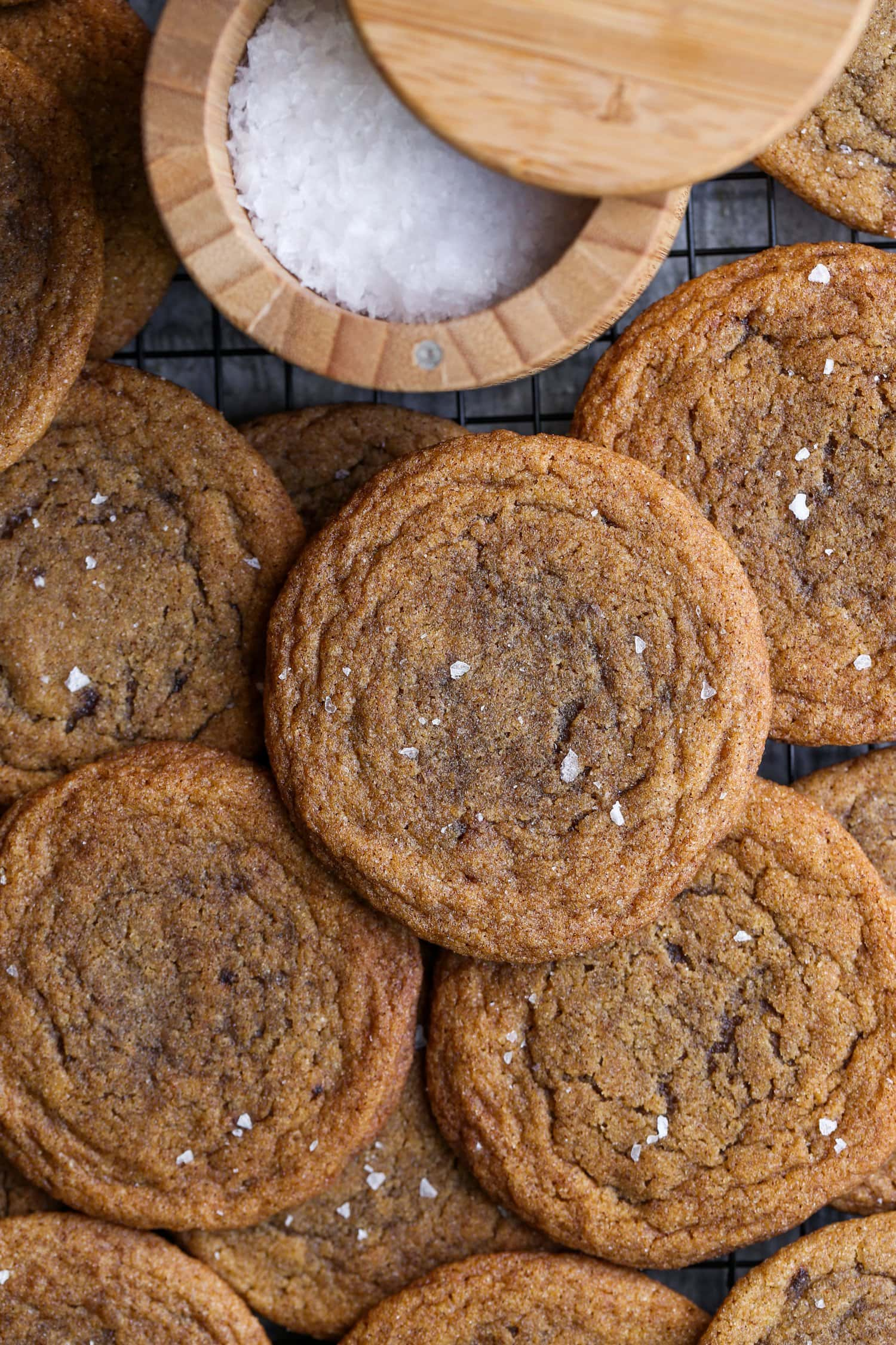 chewy pumpkin cookies with a bowl of flaked sea salt
