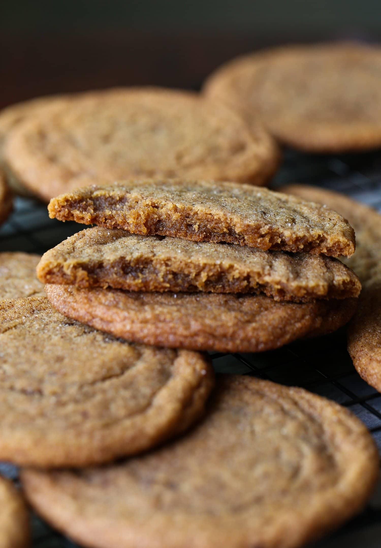 thin, chewy pumpkin cookies broken in half