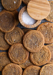 Chewy Pumpkin Cookies with flaked sea salt in a cooling rack