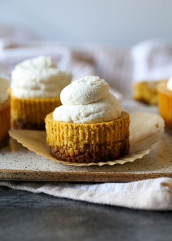 Mini Pumpkin Cheesecakes on a serving plate unwrapped