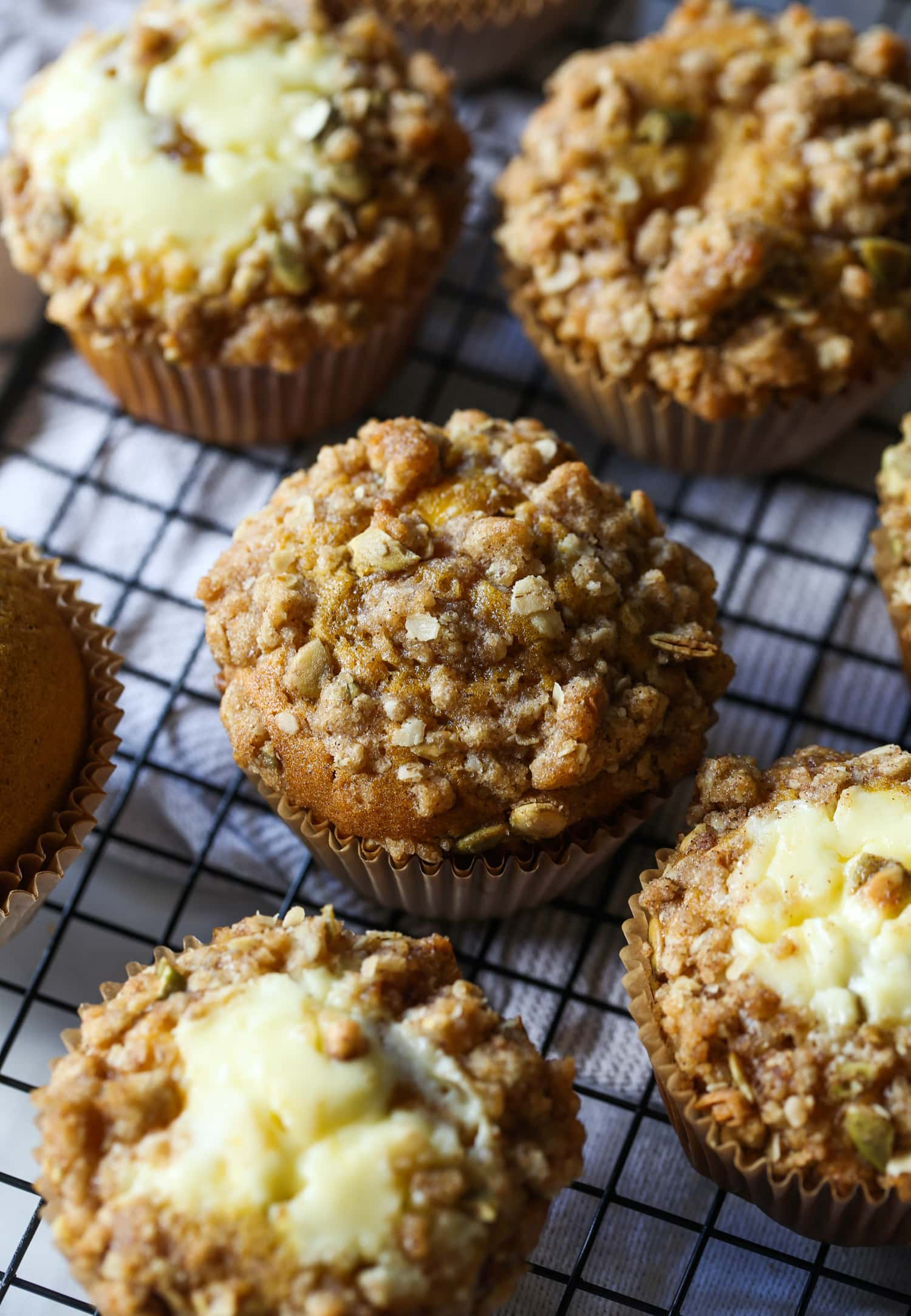 pumpkin muffin with crumble topping on a wire rack