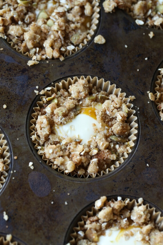 cheesecake filling inside muffin batter and crumble topping