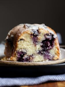 Sour Cream Blueberry Bundt Cake sliced on a plate