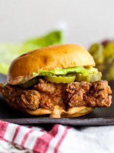 Copycat Popeyes chicken sandwich on a plate.